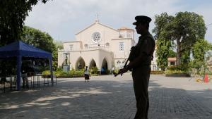 A Sri Lankan army soldier secures the premises of a Catholic church during Sunday Mass in Colombo, Sri Lanka, Sunday, May 12, 2019. (AP Photo/Eranga Jayawardena)