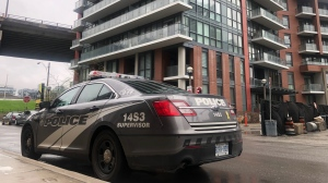 A Toronto police car is seen at a condo building in Toronto on May 14, 2019. (Peter Muscat / CTV News Toronto)