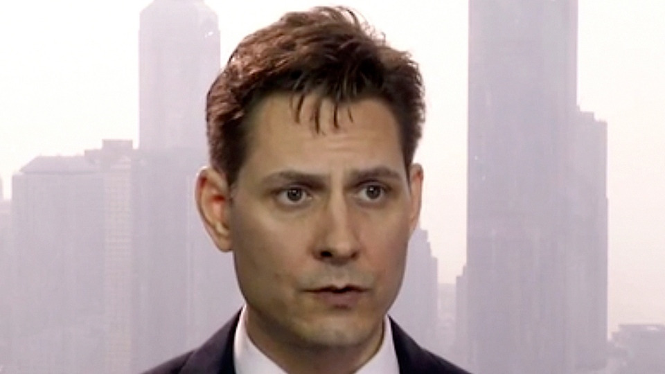 In this file image made from March 28, 2018, video, Michael Kovrig, an adviser with the International Crisis Group, a Brussels-based non-governmental organization, speaks during an interview in Hong Kong. (AP Photo, File)