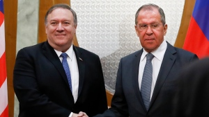 U.S. Secretary of State Mike Pompeo, left, and Russian Foreign Minister Sergey Lavrov shake hands prior to their talks in the Black Sea resort city of Sochi, southern Russia, Tuesday, May 14, 2019. (AP Photo/Pavel Golovkin, Pool)