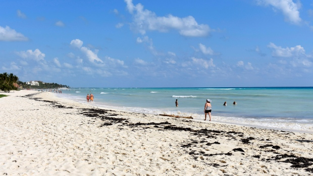 This file December 2016 photo shows a beach north of Playa del Carmen in Mexico, which stretches for miles. (AP Photo/Amir Bibawy)