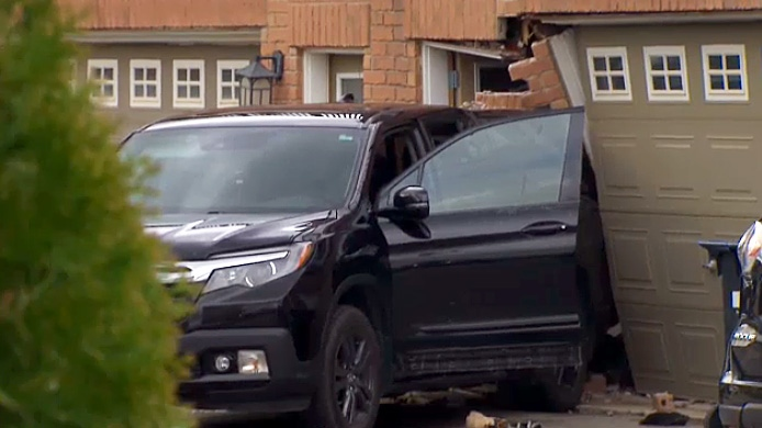 A woman and child are in hospital after being hit by a pickup truck, apparently driven by the woman's husband, in their Brampton driveway on May 14, 2019.