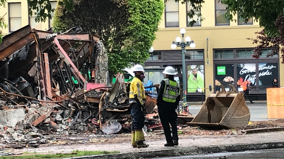 Fire officials at the scene of the former Plaza Hotel on Tuesday, May 14, 2019. (CTV Vancouver Island)