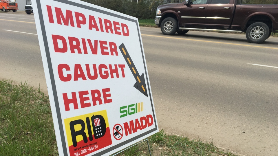 "An ""Impaired Driver Caught Here"" sign on 13th Avenue in Estevan. (Cole Davenport/CTV Regina)"