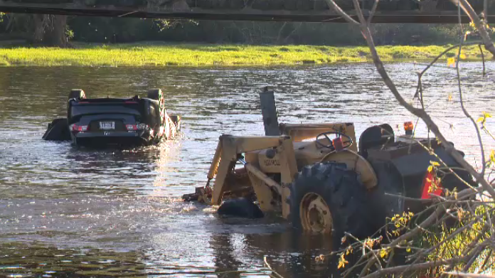 Police said one person was arrested after a vehicle crashed into the Grand River in Woolwich Township on Tuesday.