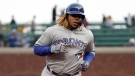 Toronto Blue Jays' Vladimir Guerrero Jr. rounds the bases after hitting a solo home run against the San Francisco Giants during the first inning of a baseball game in San Francisco, Tuesday, May 14, 2019. (AP Photo/Tony Avelar)