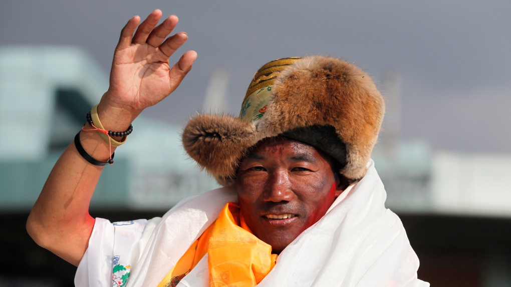 Nepal's record-setting Everest guide returns as a hero