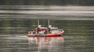 Two U.S. Coast Guard 45-foot response boats drift through George Inlet as part of a search effort on Tuesday, May 14, 2019, near Ketchikan, Alaska, at the site of a collision between two float planes. (Dustin Safranek/Ketchikan Daily News via AP)