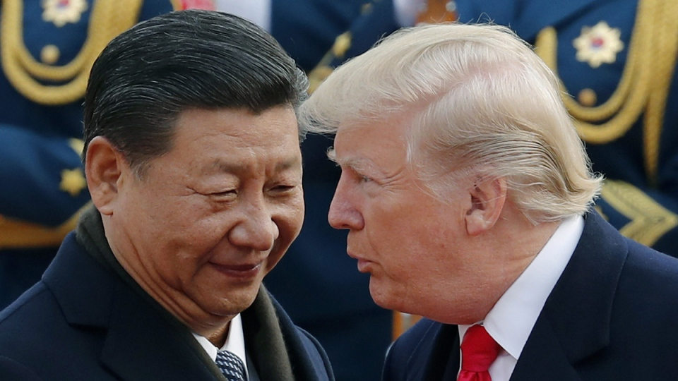 U.S. President Donald Trump, right, chats with Chinese President Xi Jinping at the Great Hall of the People in Beijing, on Nov. 9, 2017. (Andy Wong / AP)