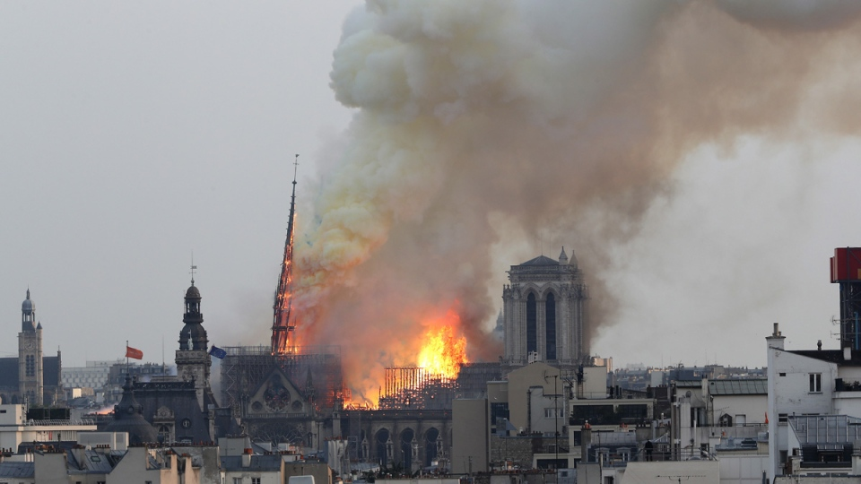 Flames rise from Notre Dame cathedral as it burns in Paris, on April 15, 2019. (Thibault Camus / AP)