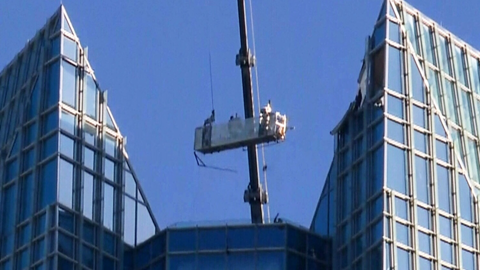 A lift occupied by window washers was jerked violently through the air during high gusts of wind in downtown Oklahoma City.