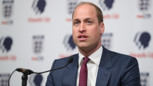 Prince William, President of the Football Association, right, speaks at the launch of a new mental health campaign at Wembley Stadium, London, Wednesday May 15, 2019. (Chris Jackson/Pool via AP)