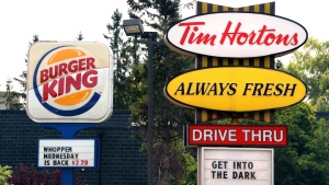 Burger King and Tim Hortons signs are displayed on St. Laurent Boulevard in Ottawa on Monday, August 25, 2014. THE CANADIAN PRESS/Sean Kilpatrick