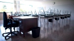 FILE - AN empty teacher's desk is pictured at the front of a empty classroom at Mcgee Secondary school in Vancouver on Sept. 5, 2014. (Jonathan Hayward/The Canadian Press)