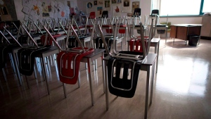 Vacant desks are pictured at the front of a empty classroom is pictured at McGee Secondary school in Vancouver on Sept. 5, 2014.  (THE CANADIAN PRESS/Jonathan Hayward)