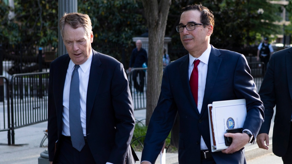 United States Trade Representative Robert Lighthizer, left, and Treasury Secretary Steven Mnuchin walk on Pennsylvania Avenue back to the White House on Thursday, May 9, 2019, in Washington. (THE CANADIAN PRESS/AP, Jon Elswick)