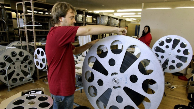 A worker prepares a movie reel