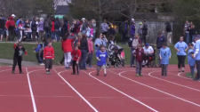 Six student athletes running a race