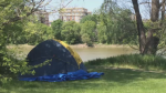 CTV file image of a camp set up on a river bank.