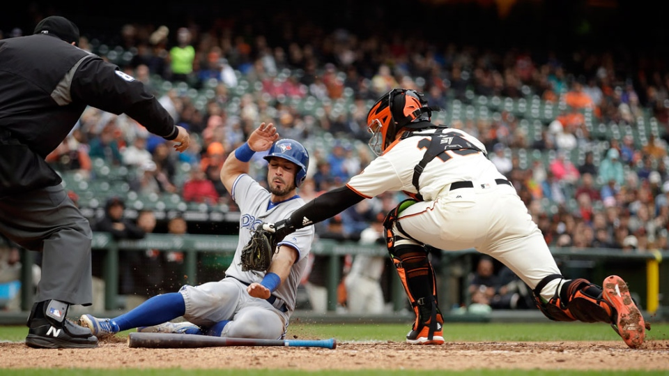 San Francisco Giants catcher Aramis Garcia, right, tags out Toronto Blue Jays' Randal Grichuk at home plate in the sixth inning of a baseball game Wednesday, May 15, 2019, in San Francisco. Grichuk was out on the double play while attempting to score on a hit by Toronto's Billy McKinney. (AP Photo/Ben Margot)