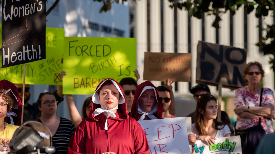 Margeaux Hartline, dressed as a handmaid, during a rally against HB314, the near-total ban on abortion bill, outside of the Alabama State House in Montgomery, Ala., on Tuesday May 14, 2019. (Mickey Welsh / The Montgomery Advertiser via AP)