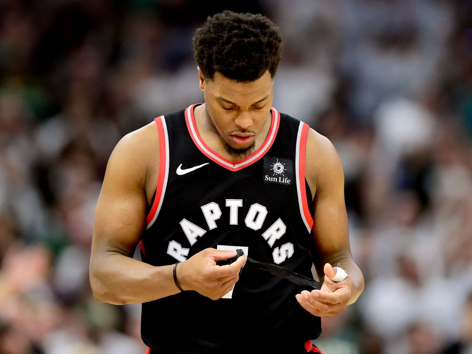 Toronto Raptors guard Kyle Lowry (7) unwraps his thumb as he walks off the court at the end of second half NBA Eastern Conference finals playoff basketball action against the Milwaukee Bucks, in Milwaukee on Wednesday, May 15, 2019. THE CANADIAN PRESS/Frank Gunn