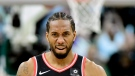 Toronto Raptors forward Kawhi Leonard (2) reacts as he walks off the court at the end of second half NBA Eastern Conference finals playoff basketball action against the Milwaukee Bucks, in Milwaukee on Wednesday, May 15, 2019. THE CANADIAN PRESS/Frank Gunn