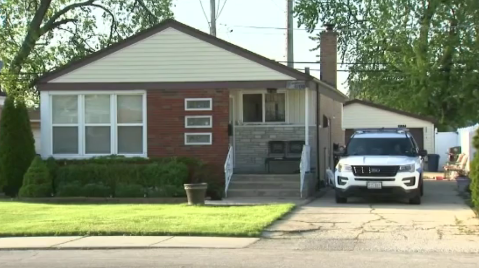 The woman's body was discovered after several people were taken into custody at a home in Chicago, according to authorities.