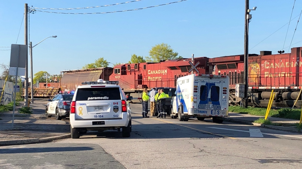 Police and paramedics at the scene of a fatal pedestrian collision involving a train on May 16, 2019.