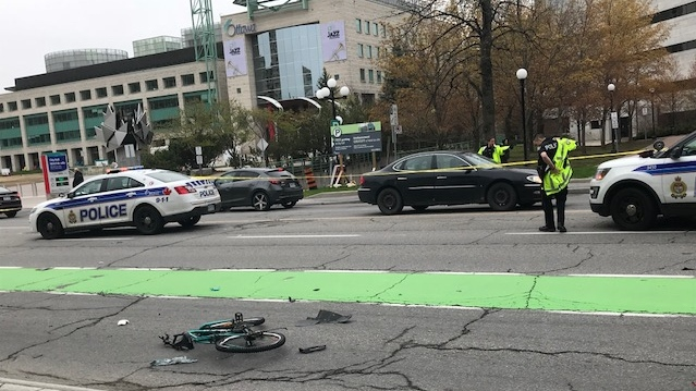 A male cyclist is in critical condition after being hit by a vehicle near Ottawa City Hall Thurs. May 16, 2019.