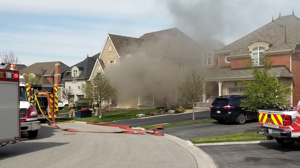 Firefighters at the scene of a house fire after a transformer explosion in Acton on May 16, 2019.