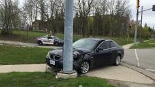 A vehicle that crashed into a light pole