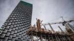 Workers assemble concrete forms at a condo tower under construction, in Vancouver on Friday, Oct. 26, 2018. THE CANADIAN PRESS/Darryl Dyck