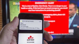 A smartphone and a television receive visual and audio alerts to test Alert Ready, a national public alert system, in Montreal on Monday, May 7, 2018.(THE CANADIAN PRESS/Ryan Remiorz)