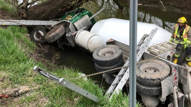 A cement truck in a creek