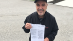 Ralph Corrente of Wasaga Beach holds a letter from the Ministry of Transportation stating his licence had been suspended on May 2, 2019 (CTV News/Krista Sharpe)