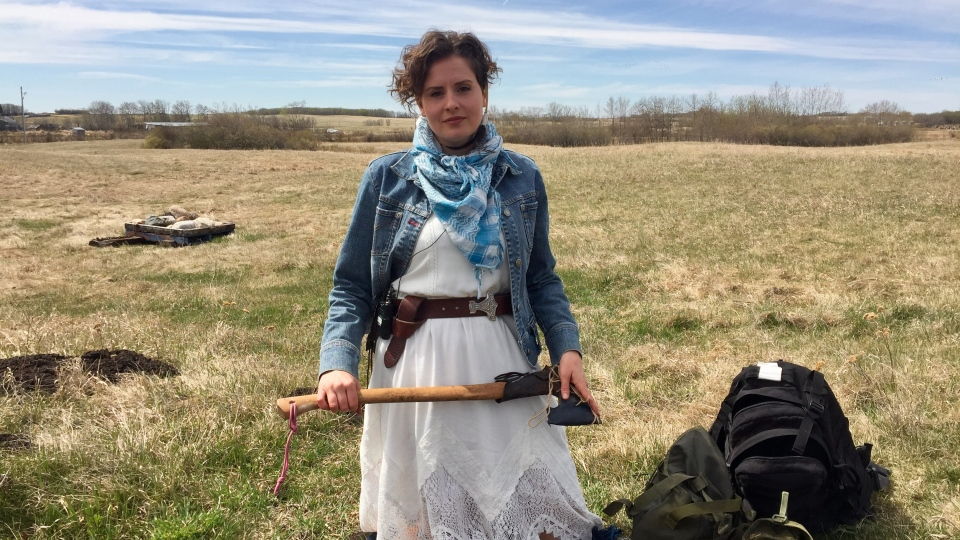 Michelle Wohlberg holds an axe, an item she brought to the Arctic, on her property near Mullingar, Sask. (Laura Woodward/CTV Saskatoon)
