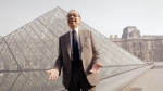 FILE - In this March 29, 1989, file photo, Chinese-American architect I.M. Pei laughs while posing for a portrait in front of the Louvre glass pyramid, which he designed, in the museum's Napoleon Courtyard, prior to its inauguration in Paris. (AP Photo/Pierre Gleizes, File)