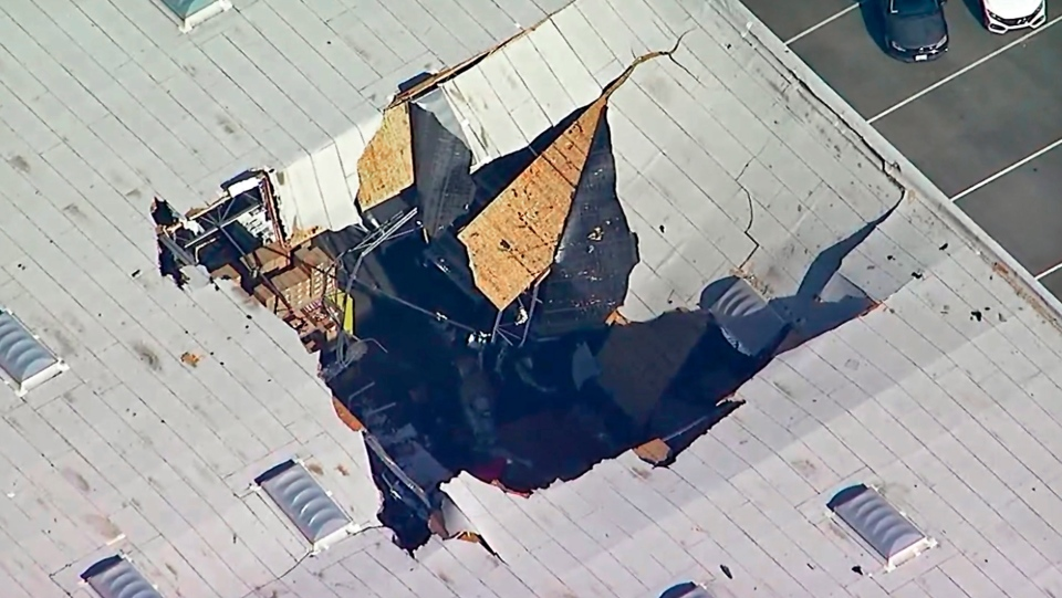This photo taken from video provided by KABC-TV shows where an F-16 fighter jet crashed into a warehouse just outside March Air Reserve Base in Riverside, Calif., Thursday afternoon, May 16, 2019. (KABC-TV via AP)