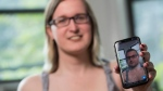 In this Wednesday, May 15, 2019, photo, Bailey Coffman shows her photo as a man in the Snapchat app during an interview in New York. Snapchat's new photo filter that allows users to change into a man or woman with the tap of a finger isn't necessarily fun and games for transgender people. (AP Photo/Mary Altaffer)