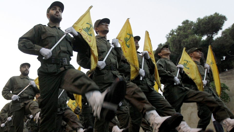 In this Nov. 12, 2010 file photo, Hezbollah fighters parade in a southern suburb of Beirut, Lebanon. (Hussein Malla / AP)