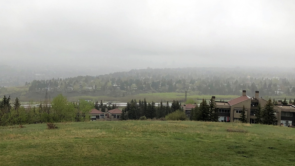 A misty haze hangs over Calgary's downtown and about 10 - 20 mm of rain is expected for the weekend.