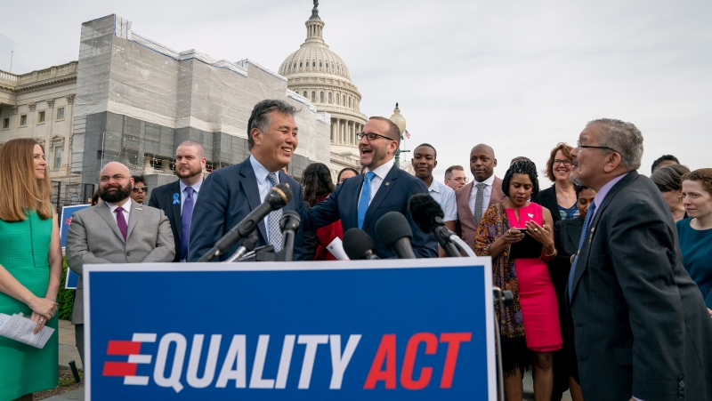 "Rep. Mark Takano, D-Calif., left, is greeted by Chad Griffin, president of the Human Rights Campaign, as they and other advocates for LGBTQ rights rally before a vote in the House on the ""Equality Act of 2019,"" sweeping anti-discrimination legislation that would extend civil rights protections to LGBT people by prohibiting discrimination based on sexual orientation or gender identity, at the Capitol in Washington, Friday, May 17, 2019. (AP Photo/J. Scott Applewhite)"