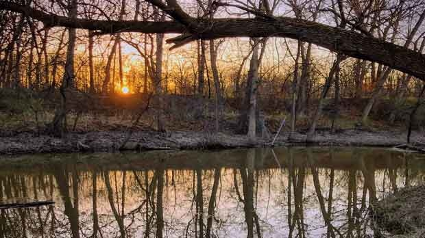 Sunset over the Seine River along the Niakwa Trail. Photo by Jeff Vernaus.