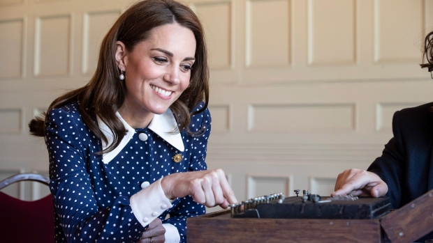 Kate, the Duchess of Cambridge uses a German Enigma machine captured during WWII, during a visit to Bletchley Park to view a special D- Day exhibition in the newly restored Teleprinter Building, marking the 75th anniversary of the D-Day landings, near Milton Keynes, England, Tuesday, May 14, 2019. (Heathcliff O'Malley/Pool Photo via AP)
