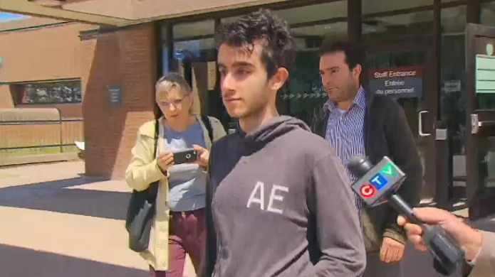 The father and son accused in a case involving the alleged discovery of explosives in Richmond Hill leaves a courtroom on May 17, 2019 after being granted bail.