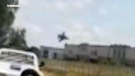 F-16 fighter jet crashes through warehouse roof