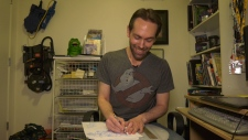 Victoria illustrator Dan Schoening draws the familiar franchise characters on printer paper before transferring them digitally. (CTV Vancouver Island)