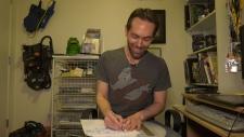 Victoria illustrator Dan Schoening draws the familiar franchise characters on printer paper before transferring them digitally. (CTV Vancouver Island)