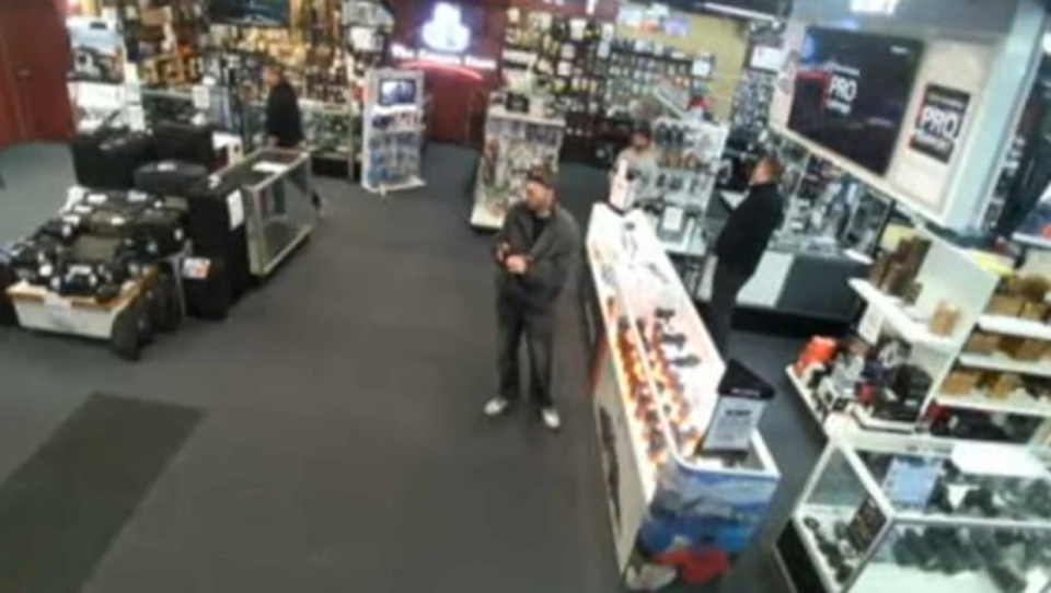 Surveillance still of the suspect in a camera theft and bear spray attack on The Camera Store staff (supplied)